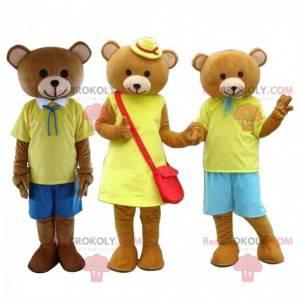 3 brune bamser maskoter kledd i gule bjørnekostymer -
