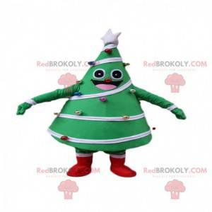 Maskot zdobený a slavnostní zelený strom, kostým vánoční