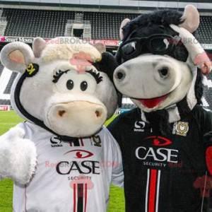 2 vacas mascotes, uma branca e uma preta - Redbrokoly.com