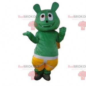 Mascota monstruo verde con pantalones cortos, traje de criatura