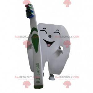 Mascotte dente gigante con uno spazzolino da denti -