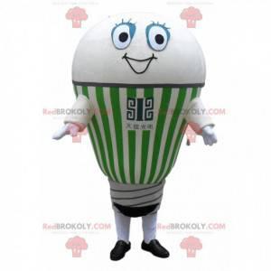 Gigantyczna biała i zielona żarówka maskotka uśmiecha się -