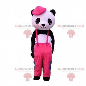 Sort og hvid panda maskot klædt i lyserøde overalls -