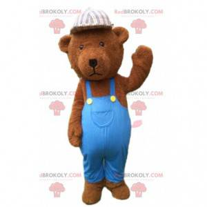 Mascote urso de pelúcia marrom vestido de azul, urso de pelúcia