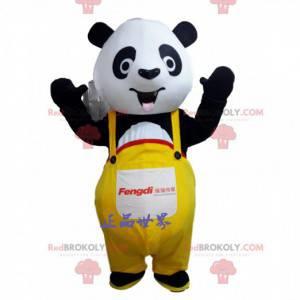 Mascote panda preto e branco com macacão amarelo -