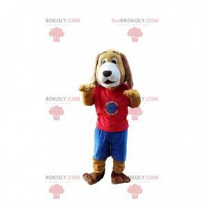 Mascote cachorro marrom e branco com roupas esportivas -