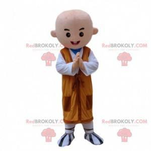 Buddhistisches Mönchmaskottchen mit einer orange Tunika -