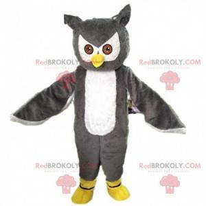 Mascote gigante e impressionante de coruja cinza e branca -
