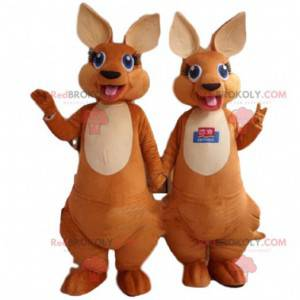 2 mascots of brown and white kangaroos with blue eyes -