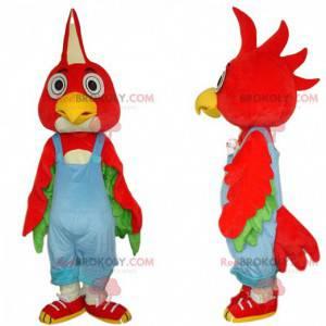 Rød fuglemaskot med blå overall, farverigt kostume -