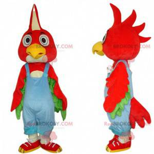 Red bird mascot with blue overalls, colorful costume -