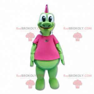 Grünes Drachenmaskottchen mit rosa Wappen - Redbrokoly.com
