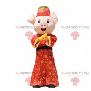 Pig mascot dressed in a traditional Asian outfit -