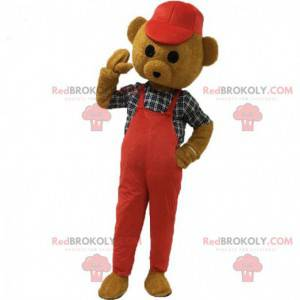 Brown teddy bear mascot dressed in red with a cap -