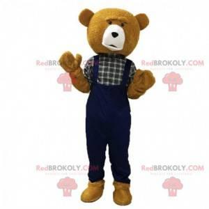 Mascote urso de pelúcia marrom, vestido de macacão -