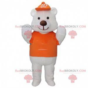 Stor hvid bjørnemaskot klædt i orange med en kasket -