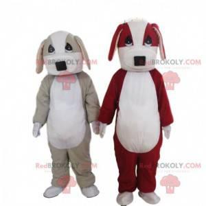 2 psí maskoti, jeden šedobílý a jeden červenobílý -