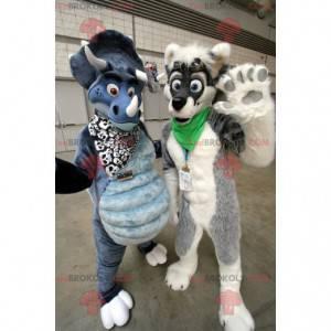 2 mascotes: um cachorro cinza e branco e um dinossauro azul -