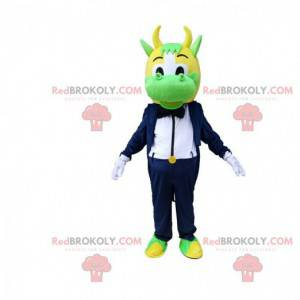 Green and yellow cow mascot dressed in elegant tuxedo -
