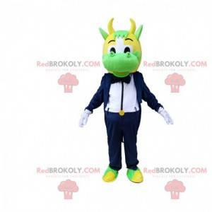 Mascotte mucca verde e gialla vestita in smoking elegante -