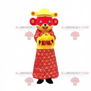 Mascote rato vermelho e amarelo vestido com uma roupa asiática