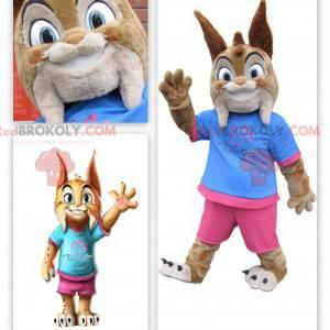Schattige kleine lynx mascotte gekleed in roze en blauw -