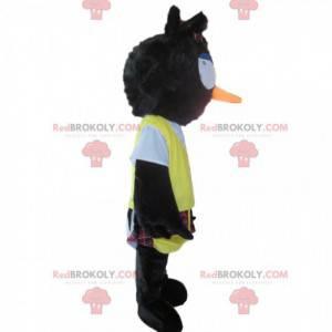 Mascote pássaro preto desgrenhado com saiote e babador amarelo