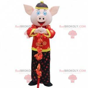 Schweinekostüm im traditionellen asiatischen Outfit -