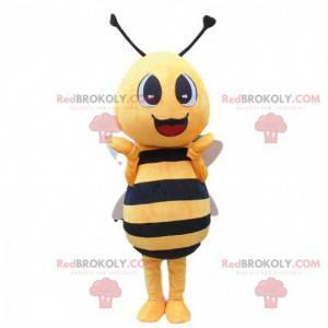 Geel en zwart bijenkostuum, reusachtig en glimlachend -
