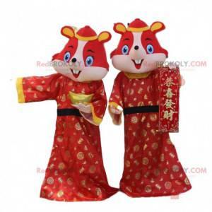2 forkledninger av røde hamstere, mus i asiatiske klær -