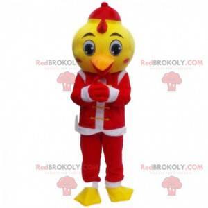 Kanarek maskotka ubrana w strój Świętego Mikołaja, kostium