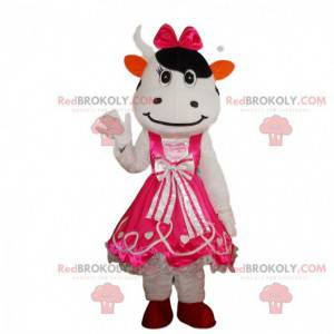 White and black cow costume wearing a pink dress -