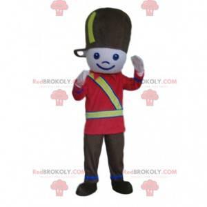 Voják maskot, chlapec v černé a červené uniformě vojáka -