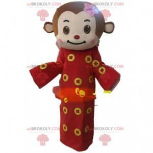 Fato de macaco marrom com túnica vermelha e amarela -