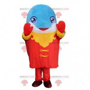 Mascote golfinho azul e branco com uma roupa colorida -