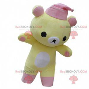 Žlutý a bílý medvídek maskot s růžovou skleničku -