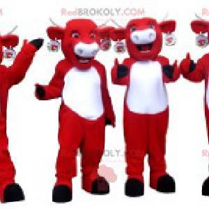 4 Kiri-Kuhmaskottchen von roten und weißen Kühen -