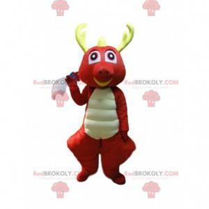 Mascota dragón rojo y blanco con cuernos amarillos -