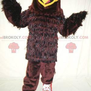 Hnědý a žlutý pták orel maskot - Redbrokoly.com