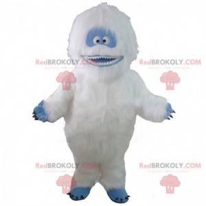 Maskot hvit og blå yeti, veldig hårete og smilende -