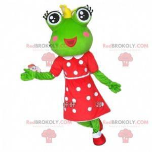 Mascota de la rana verde con una corona y un vestido de lunares