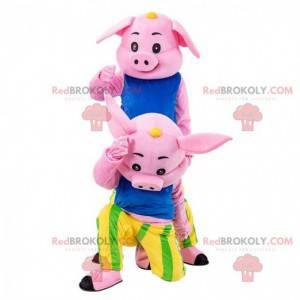2 mascotes cor de rosa, fantasias de porco coloridas -