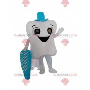 Mascote gigante de dentes brancos com uma escova de dentes azul