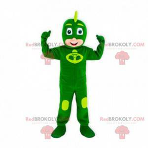 Mascota niño con una combinación verde de superhéroes. -