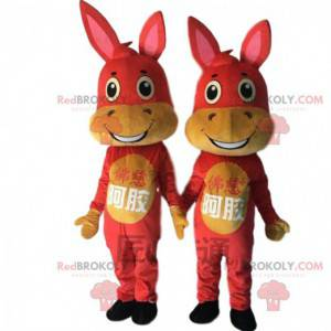2 mascots of red and yellow donkeys, donkey costumes -
