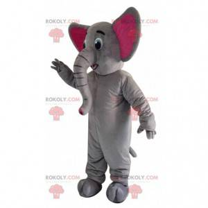 Grå og rosa elefantmaskot med stor koffert - Redbrokoly.com