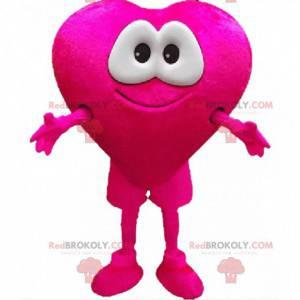 Riesiges rosa Herzmaskottchen mit hübschen berührenden Augen -