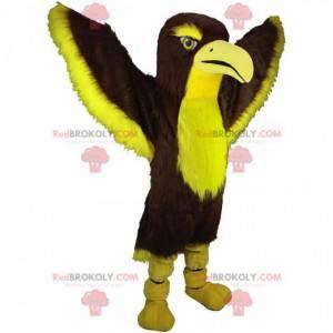 Mascote de falcão marrom e amarelo, fantasia colorida de águia