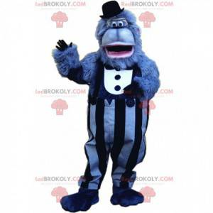 Mascote gorila azul com uma roupa elegante, gorila gigante -