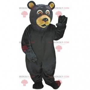 Maskot černého medvěda vypadá překvapeně, kostým medvídka -